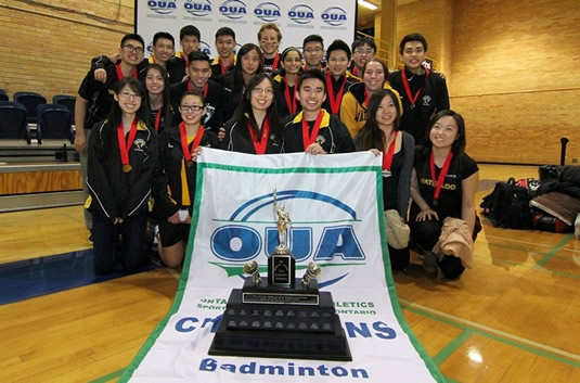 The Waterloo Warriors badminton team with their trophy.