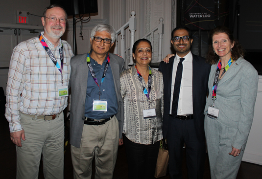 The Dean of Applied Health Sciences, Susan Elliott, Rohit Ramchandani, Rohit's parents and the interim director of the School of Public Health and Health Systems, Steve McColl.