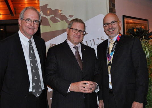 Graham Brown, (left) and Larry Swatuk (right) as they greet the Hon. Lloyd Axworthy prior to the 2012 Stanley Knowles Humanitarian Service Lecture.