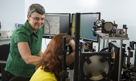 Professor Melanie Campbell and a research associate demonstrate detection equipment.