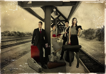 Attacca Quartet image. The quartet standing at a train station.