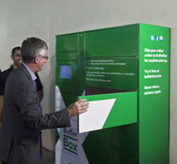 Gary McNeil, president of GO Transit, uses the first Toronto BufferBox while co-founder Jay Shah looks on.