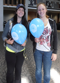 United Way student volunteers hand out balloons in the Student Life Centre.