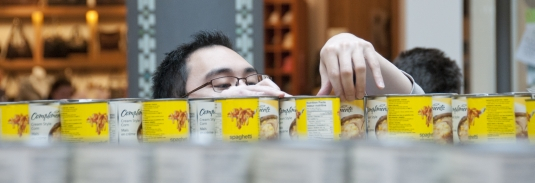 Russ Wong stacks cans for Canstruction.