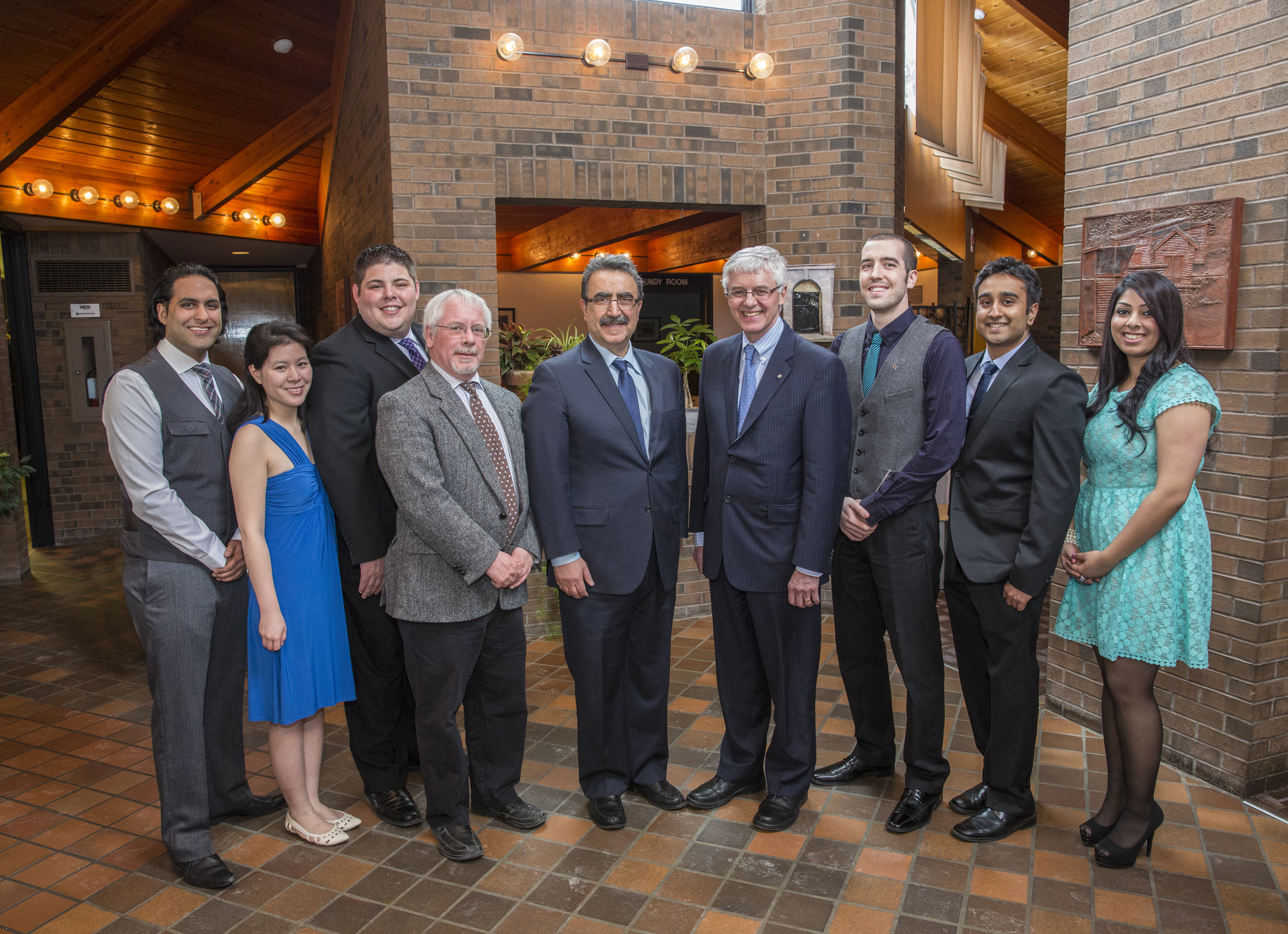Master of Public Service students pose with Dean of Arts Doug Peers, President Feridun Hamdullahpur, and Kevin Lynch.