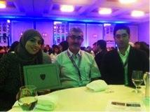 Dina Saad with her award.