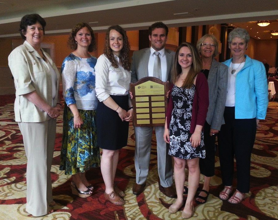 The winning team, MTEvaluators (from left to right): Wendy Rowe (Vice President of CES), Jennifer Yessis (assistant coach), Beverly Hoekstra, Nathan Honsberger, Corrie Vincent, Anita Myers (head coach), Bea Courtney (from Goss Gilroy Inc.)