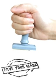 """""""Make your mark,"""" poster with a hand using a stamp."""